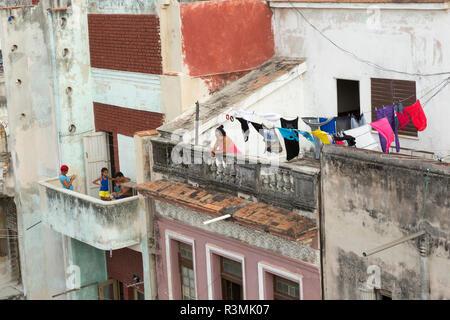 Cuba, Havana. People on their balconies. Credit as: Wendy Kaveney / Jaynes Gallery / DanitaDelimont.com - Stock Image