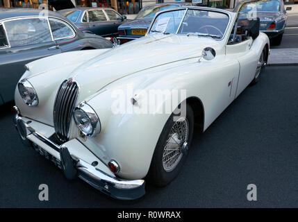 Three-quarter front view of a  1954, white, Jaguar XK 140  on display at the Regents Street Motor Show, 2018 - Stock Image