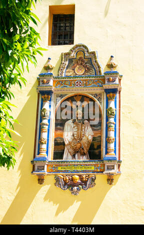Painting of Jesus on the outside wall of a church on Calle Feria in Seville - Stock Image