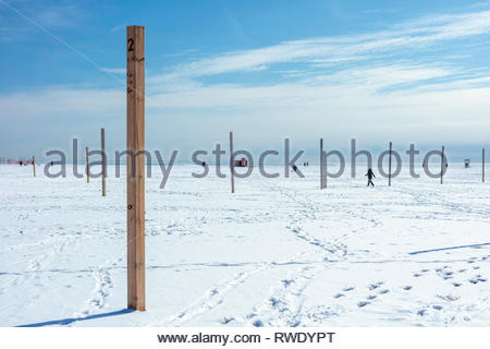 Posts of unused volleyball court at Woodbine Beach in winter in The Beaches area of Toronto Ontario Canada - Stock Image