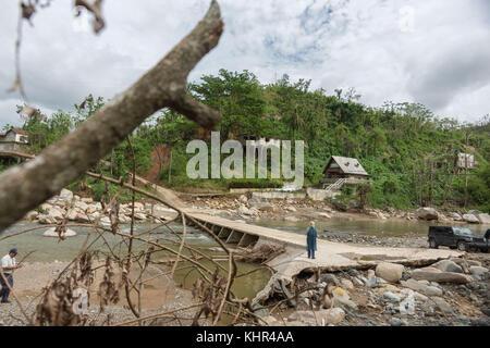 A damaged bridge in the Salto Arriba neighborhood in the aftermath of Hurricane Maria November 9, 2017 in Utuado, - Stock Image