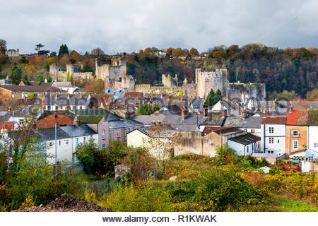 Chepstow castle, Wales, UK. View looking over the town roof tops towards the castle during Autumn. - Stock Image