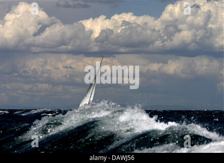 A sailing boat shown in the choppy Mediterranean off the coast of Valencia, Spain, 1 May 2007. Round Robin Two's - Stock Image