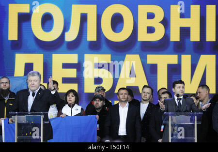 Kiev, Ukraine. 19th Apr, 2019. Ukrainian President and Presidential candidate PETRO POROSHENKO (L) and Ukrainian comedian actor and presidential candidate VOLODYMYR ZELENSKIY (R) speak during debate at the Olimpiyskiy Stadium in Kiev, Ukraine, 19 April 2019. The second round of presidential elections will held on April 21. Credit: Serg Glovny/ZUMA Wire/Alamy Live News - Stock Image