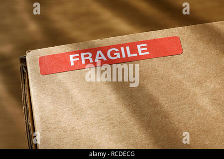 A Fragile sticker on a wcardboard box - Stock Image