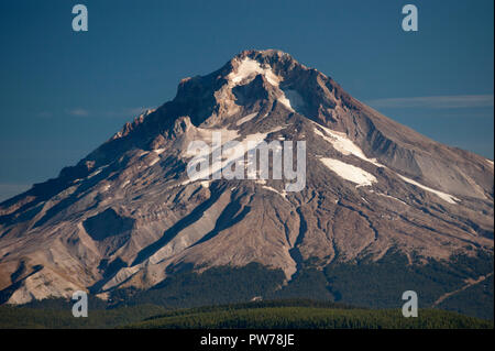 The lava dome in Mt. Hood's crater, built after the last eruption in the 1790's, is easily visible in this shot of its SW face about 15 miles away. - Stock Image