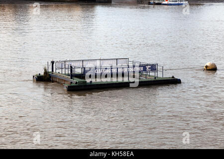 Rubbish collecting barge on the River Thames, London - Stock Image