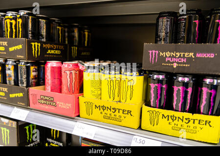 Monster energy drinks for sale in a supermarket, UK. - Stock Image