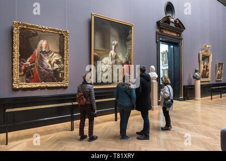 Vienna Kunsthistorisches, rear view of tourists inside the Kunsthistorisches Museum in Vienna looking at 18th century portraits, Wien, Austria. - Stock Image