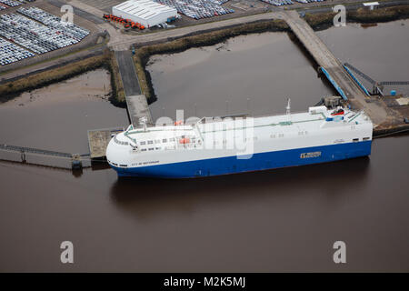 An aerial view of a car carrier unloading at a British port - Stock Image