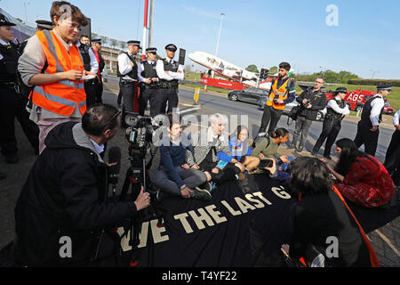 Extinction Rebellion demonstrators at London Heathrow airport. - Stock Image