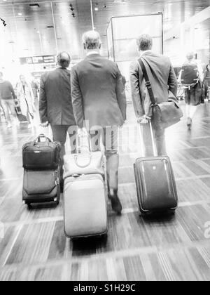 Business men at an airport - Stock Image