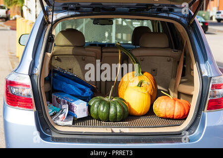 JONESBOROUGH, TN, USA-9/29/18: An SUV trunk is open, showing a variety of melons. - Stock Image