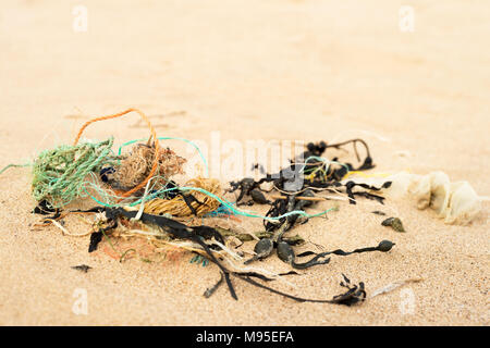 Discarded nylon rope on a beach - Stock Image