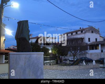 Village square at dusk, Xanthates, Corfu, Greece - Stock Image