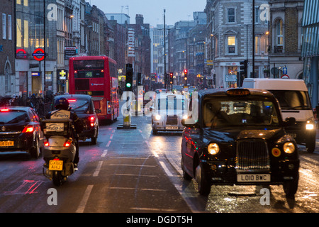 Busy London traffic at dusk in Winter - Stock Image
