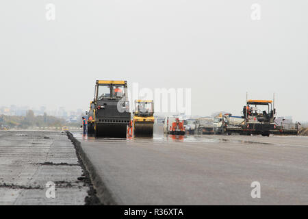 A shot of drum rollers and paving machines - Stock Image
