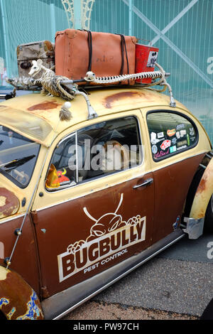 Brighton UK 14th October 2018 - This passenger looks a bit fed up in an old VW car as thousands of bikers and custom car enthusiasts enjoy this years Brightona Motorcycle event along Madeira Drive on Brighton seafront raising money for the Sussex Heart Charity Credit: Simon Dack/Alamy Live News - Stock Image
