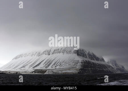 Snowy Mountains outside Longearbyen, Viewed from Water. Svalbard, Norway - Stock Image
