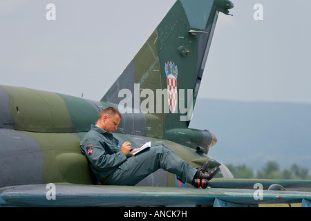 Croatian Air Force MiG-21 BISD fighter, Pleso AFB during 'open day' visit in 2007, pilot is writing notes - Stock Image