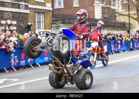 Moto Stunts International motorbike display team at London New Year's Day Parade. Quad bike wheelie in Whitehall - Stock Image