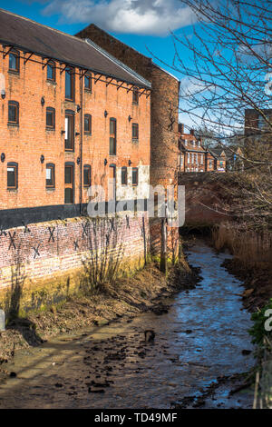 Victorian warehouses on river tributary in Kings Lynn, Norfolk, England, United Kingdom, Europe - Stock Image