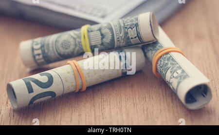 Rolled US Dollars symbolized as food product - Stock Image