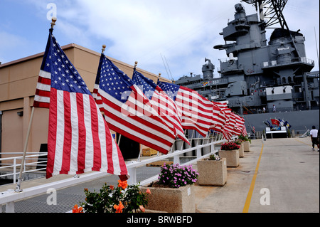 Approach to the USS Missouri, lined with USA flags. Battleship Missouri Memorial, Pearl Harbour, Hawaii - Stock Image