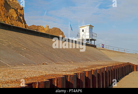 An RNLI Lifeguards hut atop the seawall on the North Norfolk coast at West Runton, Norfolk, England, United Kingdom, Europe. - Stock Image