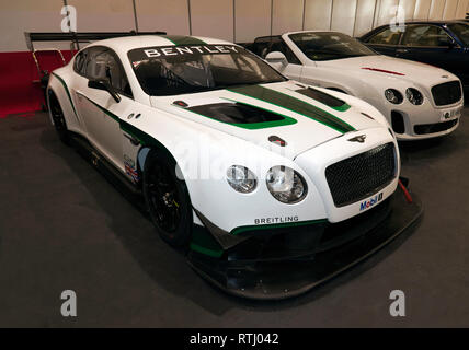 Three-quarter front view of a 2017 Bentley Continental GT3, on display in the Paddock Area of the 2019 London Classic Car Show - Stock Image