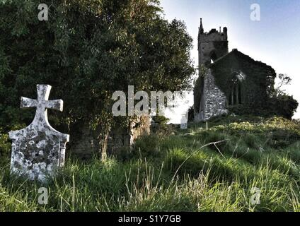 Derelict church and gravestones, Ballymore, Eire, Europe. - Stock Image