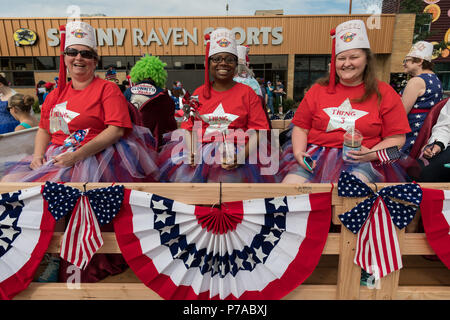 Anchorage, Alaska. 4th July, 2018. Members of the Shriners dressed in patriotic colors ride in a float during the annual Independence Day parade July 4, 2018 in Anchorage, Alaska. Credit: Planetpix/Alamy Live News - Stock Image