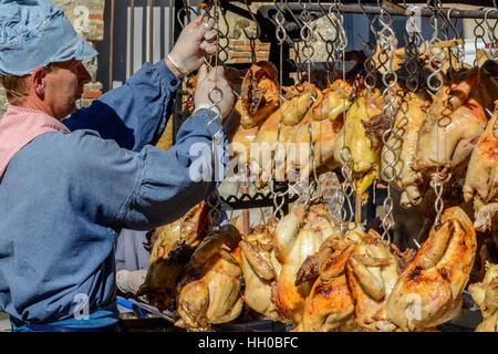 Grilled chicken on a traditional market in Normandy, France - Stock Image