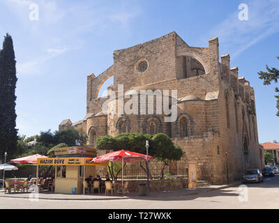 Former Church of Sts. Peter and Paul now named Sinan Paşa Mosque in Famagusta Cyprus, used for concerts and events with an outdoor cafe - Stock Image