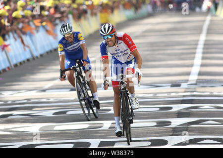 Macon to Saint-Etienne, France. 13th July 2019. Macon to Saint-Etienne, France. Macon to Saint-Etienne, France. 13th July 2019, Macon to Saint-Etienne, France; Tour de France cycling tour, stage 8; French Julian Alaphilippe, Deceuninck - Quick - Step and right Thibaut Pinot, (FRA) Groupama - Fdj cross the finish line Credit: Action Plus Sports Images/Alamy Live News Credit: Action Plus Sports Images/Alamy Live News Credit: Action Plus Sports Images/Alamy Live News - Stock Image
