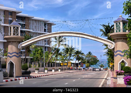 Approach road with arch entrance to Pattaya city and beach, Thailand, Southeast Asia - Stock Image
