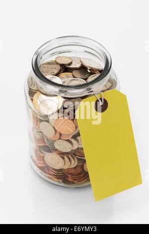 Savings Jar with tag - Stock Image