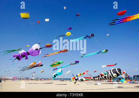CERVIA, ITALY, APRIL 2018: Many colorful kites in different shapes at Cervia international kite festival Artevento 2018, located on pinarella beach - Stock Image