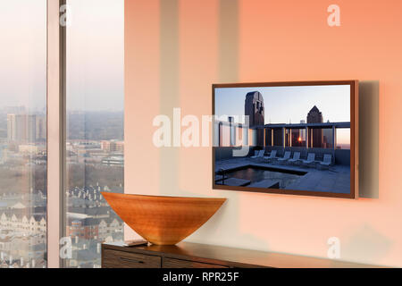 Flat Screen TV on Wall at Sunset - Stock Image