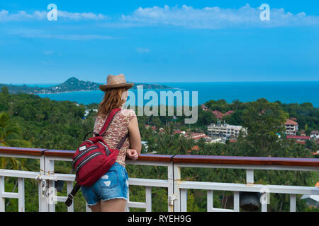 Tourist girl standing on observation deck Lamai viewpoint in Samui island, Thailand - Stock Image
