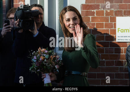Lewisham, London, UK. 22nd January, 2019. HRH The Duchess of Cambridge is presented with a posy by Helena, a carer from Lewisham, as she leaves Family Action after launching their new service 'FamilyLine'   Family Line uses a network of volunteers from across the country to support parents and carers virtually through telephone calls, email and text messaging. Credit: amanda rose/Alamy Live News - Stock Image