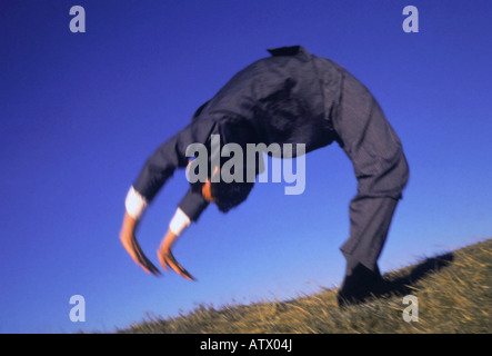 businessman doing a back bend - Stock Image