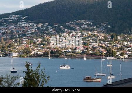 Yachts at anchor at Sandy Bay on the Derwent Estuary, Hobart, Tasmania, Australia - Stock Image