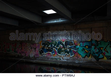 Graffiti on a wall underneath the Gravelly Hill Interchange, alongside the Tame Valley Canal. Birmingham, West Midlands, UK. - Stock Image