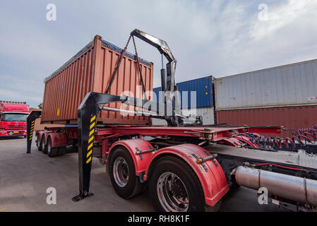 A Side Lifter or Side Loader trailer unloading a shipping container in a trucking yard in Sydney Australia - Stock Image