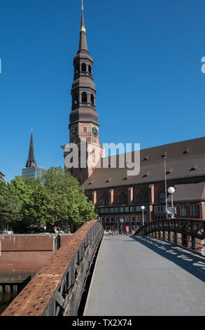 Spire of St Catherine's Church (St. Katharinen), a brick gothic Lutheran church in Speicherstadt district, Hamburg, Germany. - Stock Image