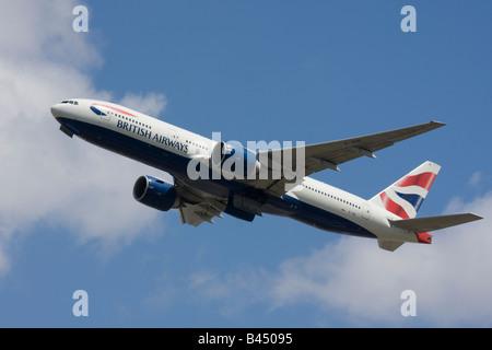 British Airways Boeing 777-236/ER taking off. - Stock Image