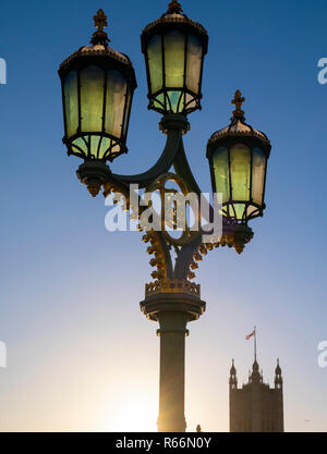 Old lamp and parliament with flag flying, London, UK. - Stock Image