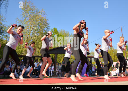 Nis, Serbia - April 20, 2019 Group of young people practicing Piloxing outside in park on sunny day - Stock Image