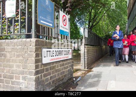School children on an excursion walking down LIttle Dorrit Court in Southwark, London, SE1, UK - Stock Image